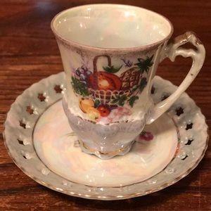 Iridescent demitasse teacup with fruit motif